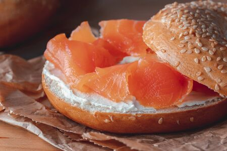 Fresh made Bagel with Salmon on old wooden table Stock Photo - 146301395