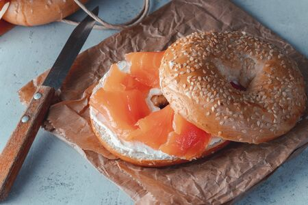 Fresh made Bagel with Salmon on paper.