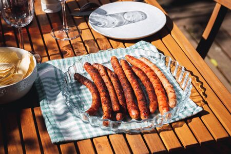 Pork chipolata. Close-up view of fried sausages. Meat dish. Stock Photo - 149839766