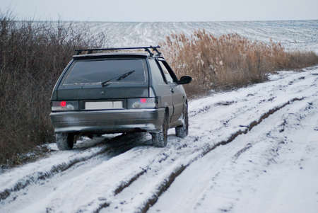 winter tires: The car on a winter dirt road.