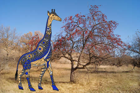 traditional pattern: Painted giraffe on a background of nature photography.