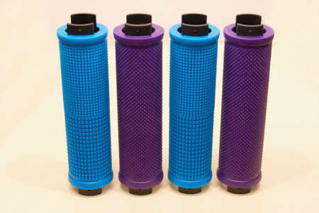 Colored bicycle grips close-up on a light background