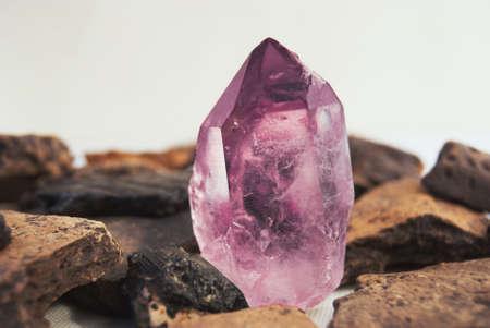 diamond stones: Large quartz crystal on white background close-up.