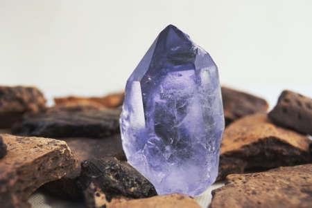 Large quartz crystal on white background close-up.