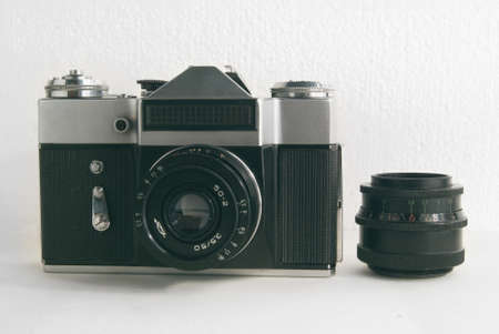 shutter aperture: Old Soviet film camera with lens on white background close-up.