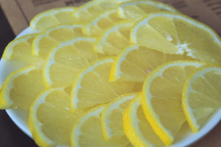 Sliced lemon slices on a plate in a cafe