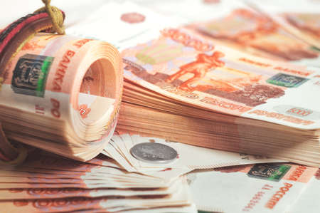Million Russian rubles. The concept of wealth, profits, business and finance. A much money in the five thousandth bills banknotes. A lots wads of money. Stock Photo