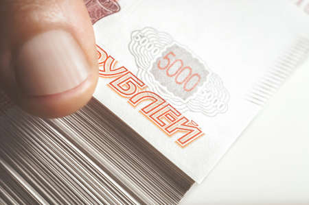 Million Russian rubles. The concept of wealth, profits, business and finance. Stack money in the five thousandth bills banknotes. A lots wads of money, many cash Stock Photo