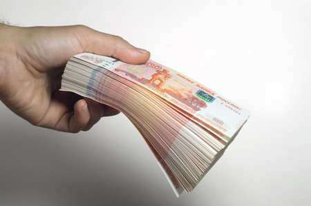 Million Russian rubles. The concept of wealth, profits, business and finance. A much money in the five thousandth bills banknotes. A lots wads of money.