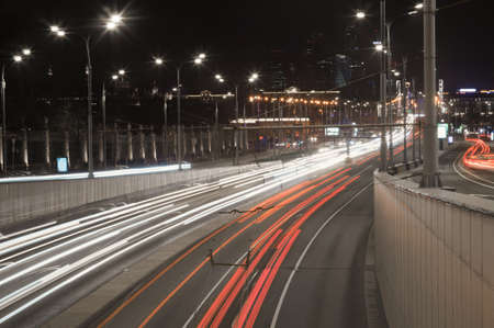 Night city capital Moscow. Lighted roads and streets. Light trace on industrial megalopolis background Stock Photo