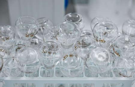 Empty clear glass medicine bottles. Medical manufacturing background