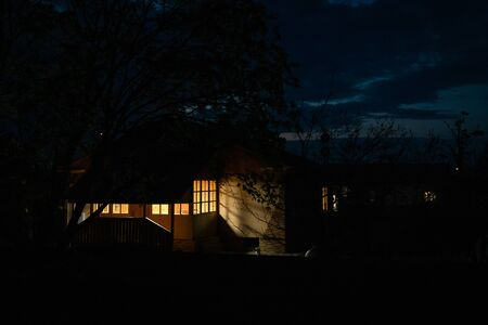 Beautiful cozy veranda glows at night