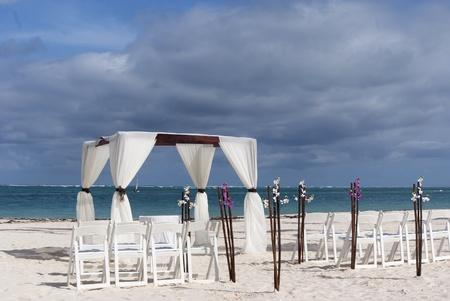 Tropical settings for a wedding on a beach photo