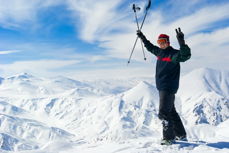 anatolia: Cheerful skier  on the top of mountain Ejder. Palandoken, turkish ski resort near Erzurum. Eastern Anatolia Stock Photo