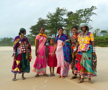 GOA, INDIA - SEPTEMBER 18, 2011: Indian women in traditional dress pose in front of camera on Goa beach, SEPTEMBER 18, 2011 Stock Photo - 11366947