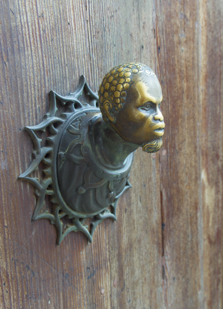 Antique doorknob of ancient door -  vintage architectural detail, Italy photo