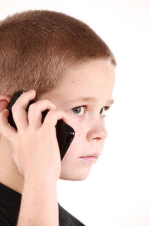 Young boy is holding the phone and wait for call Stock Photo