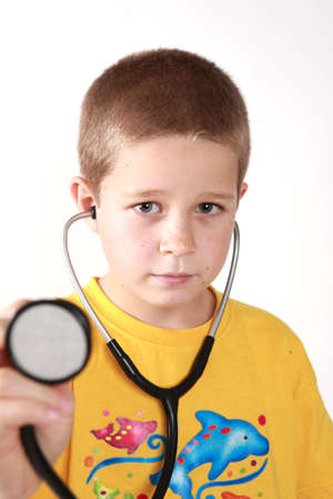 auscultoscope: Young boys direct look into camera with auscultoscope wearing