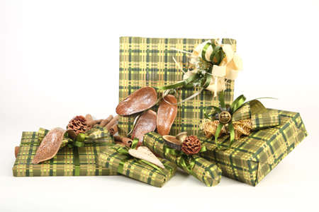 Five christmas presents in green paper with unusual decorations Stock Photo