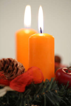 advent candles: Two orange candles on the advent wreath