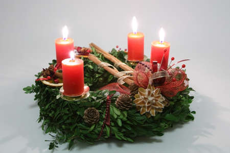 Advent wreath with four orange candles