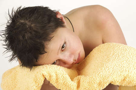 taking bath: Boy with yellow towel after taking bath Stock Photo