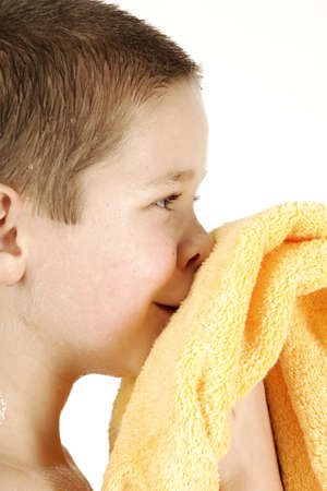 Boy with yellow towel after taking bath Stock Photo