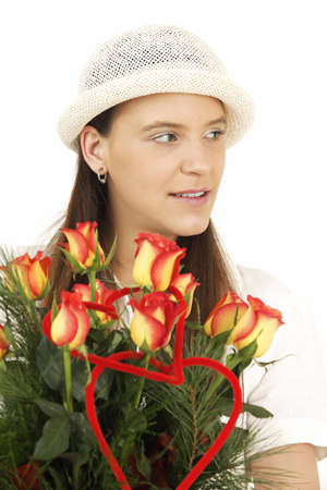Woman keeps flowers and smiles photo