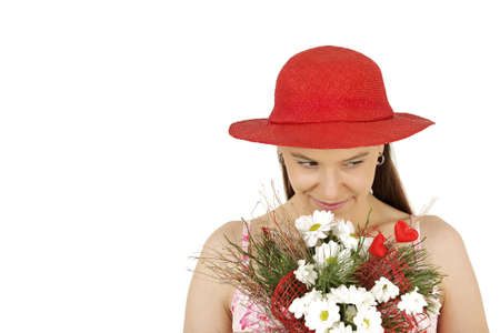 Young woman in red hat with flowers isolated photo