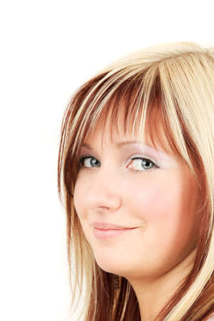 bangs: Side view portrait of young smiling blonde woman, studio shot Stock Photo