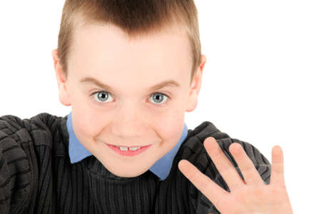 Portrait of young boy waving, studio shot photo