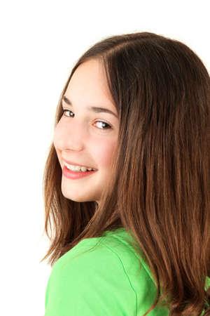 Portrait of young smiling teenage girl, studio shot Stock Photo