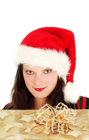Young woman in Santa hat with christmas present, studio shot Stock Photo