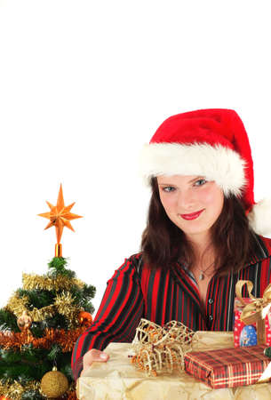 Young woman in Santa hat with christmas presents, studio shot Stock Photo