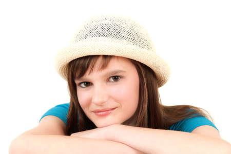 Portrait of young teenage girl in hat, studio shot