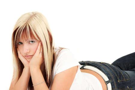 Portrait of worried young blonde woman lying down, studio shot Stock Photo - 5660695