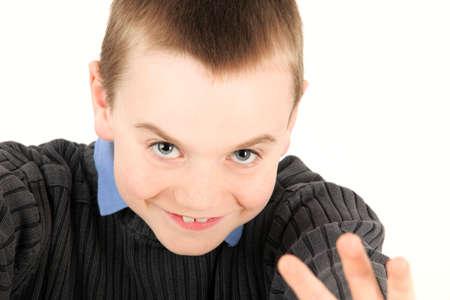 Portrait of young boy waving, studio shot Stock Photo - 5660697