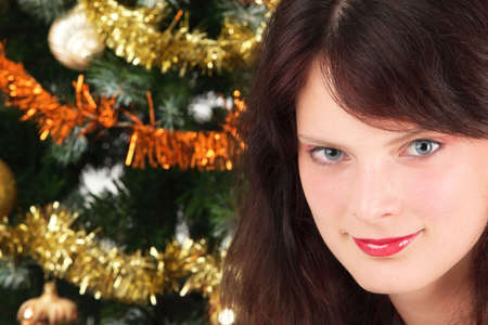 Young girl in front of the christmas tree photo