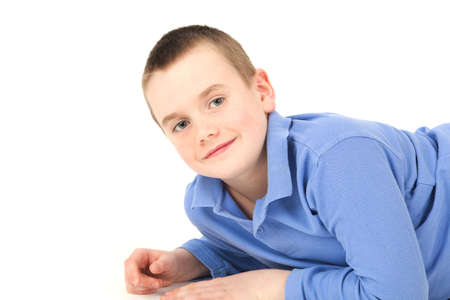 Portrait of young boy lying down, studio shot