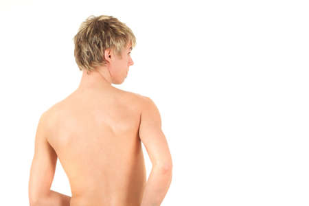 Rear view of naked boy, studio shot photo