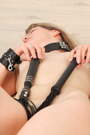 Portrait of young woman in bondage lying down on floor Stock Photo - 6068401