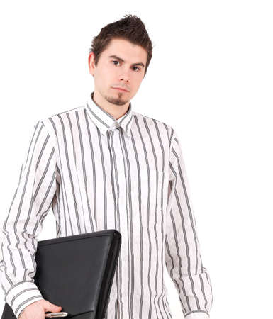 Portrait of young man in striped shirt holding folder and pen, studio shot photo