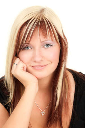 Portrait of young smiling blonde woman, studio shot photo