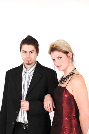 Portrait of young elegant couple with arms linked, studio shot photo