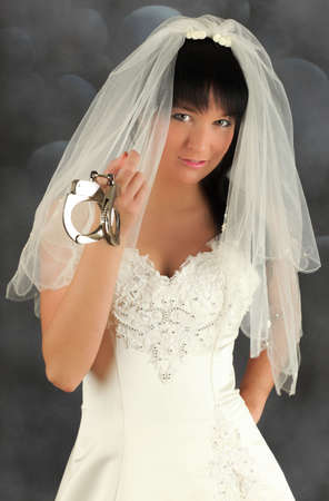 handcuffs female: Portrait of an young bride offering marriage