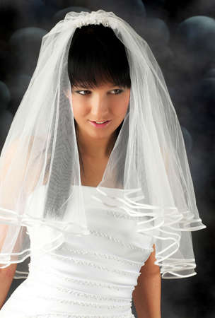 Portrait of an young, beautiful bride in white wedding dress photo