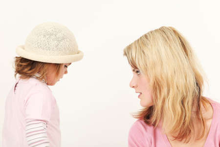 Portrait of young mother and daughter, studio shot Stock Photo