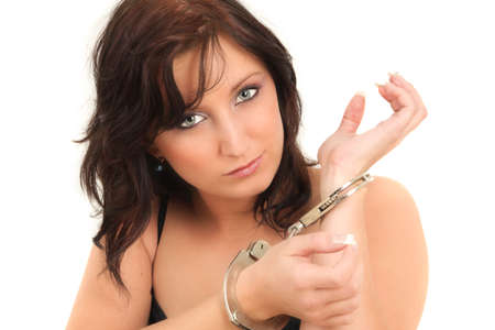 Portrait of young handcuffed girl, studio shot Stock Photo - 6816609