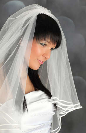 Portrait of an young atrractive bride in wedding dress photo