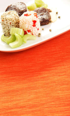 A beef steak served on green pepper with celery and rice
